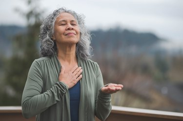 Hawaiian woman doing breathing exercises for COPD outside
