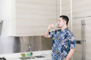 Man drinking water for New Year's resolution