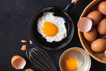 Directly above shot of eggs, a major food allergen, and egg on table