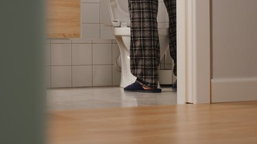 legs of adult man going to the bathroom at home, as a natural remedy for enlarged prostate