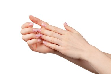Well-groomed female hands with manicure on white background