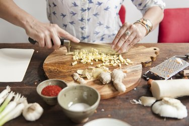 a person chopping ginger, as a toothache remedy