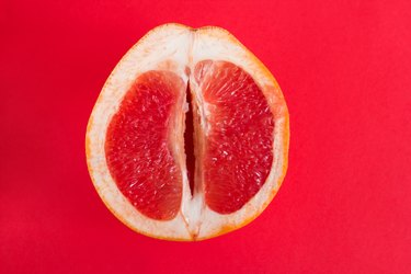 half of fresh ripe grapefruit that looks like a vagina to represent sweet-smelling vaginal odor