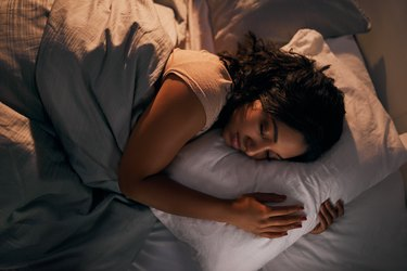 a person sleeping in bed