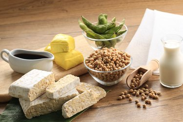 Soy Product: Raw Tofu, Tempeh, Soy Milk, Soy Sauce, and Soy Bean. Concept of Healthy Vegetarian Food