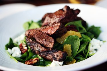 A plate of steak over salad, as a natural remedy for canker sores