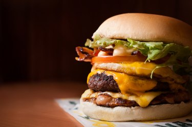 Close view of a fast food cheeseburger with bacon