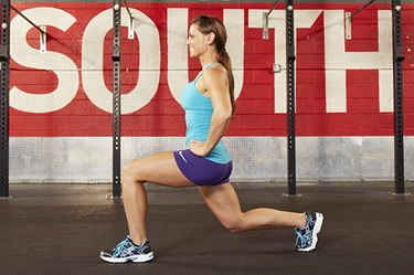 Woman performing CrossFit lunge.