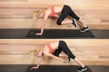 Woman performing tripos bear crawl ab exercise.