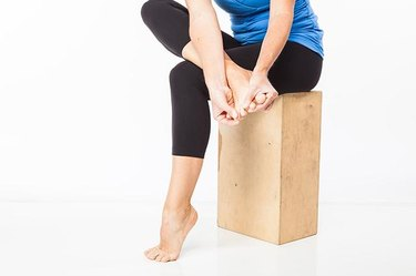 Woman demonstrating passive toe spreading.