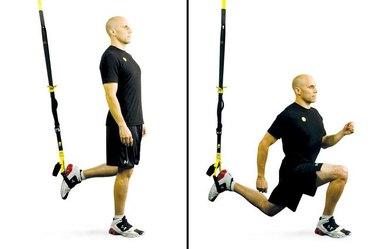 Man performing TRX lunge.