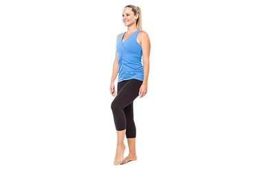Woman demonstrating single-leg balance.