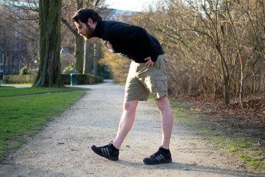 Man performing heel-toe walks before a bike ride