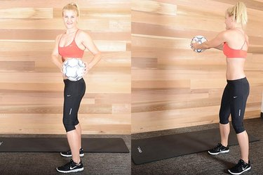 Woman performing twist and toss exercise ab exercise.