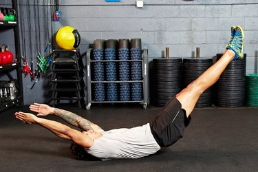 Man doing hollow body rock ab exercise