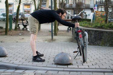 Man performing chest stretch before a bike ride