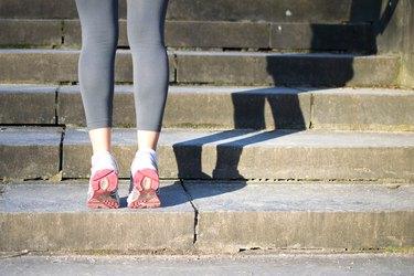Woman doing Calf Raises before her run