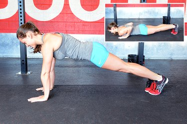 Woman performing push-up exercise.