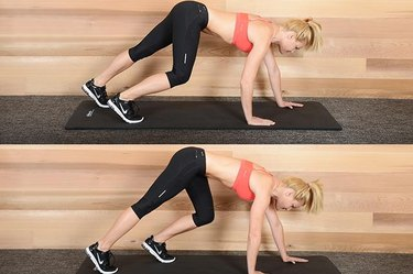 Woman performing bear crawl exercise ab exercise.