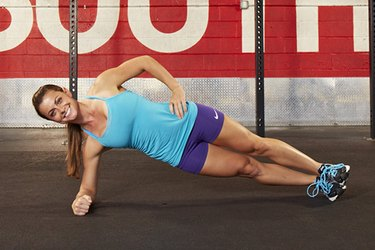 Woman performing CrossFit side plank.