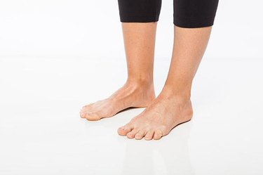 Woman demonstrating active toe spreading.