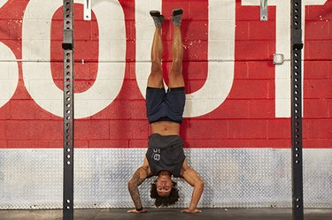 Man performing handstand push-ups.