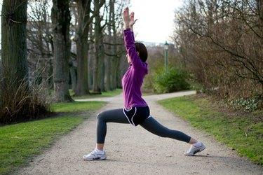Woman doing Kneeling Hip Flexor Stretches before running