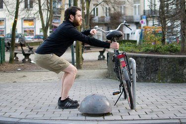 Man performing active squat before a bike ride