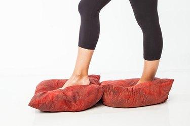 Woman demonstrating walking on pillows.