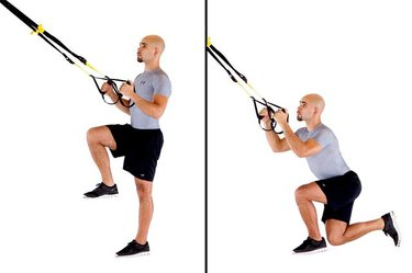 Man performing crossing balance lunge TRX exercise