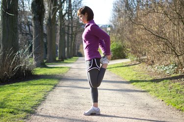 Woman doing Standing Quad Stretches before running