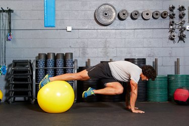 Man doing an ab exercise on a Swiss ball