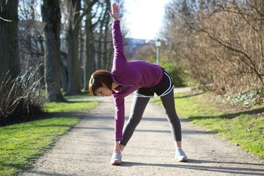 Woman doing dynamic stretching before running