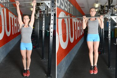 Woman performing pull-ups.