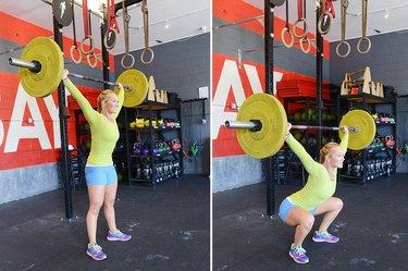 Woman performing overhead squat.