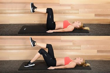 Woman performing toe tap exercise ab exercise.
