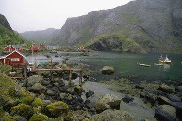 Boats in water near a village, Nusfjord, Lofoten Islands, Norway