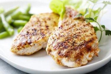 seasoned grilled chicken breast on plate