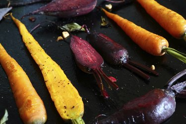 baked carrots and beets on  baking sheet