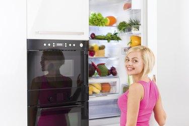 woman refrigerator open door