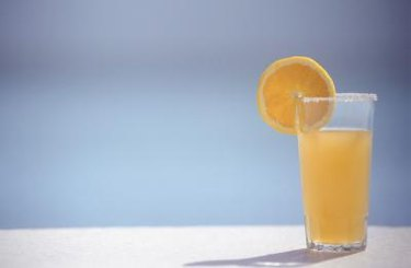 Orange juice, an orange slice, garnish