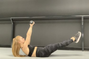 certified trainer stacey zielinski demonstrates hollow body hold progression with dumbbells