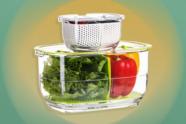 Food storage container with a partition in the middle, holding lettuce leaves and two bell peppers over yellow and green background.
