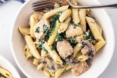 Diced chicken florentine with penne pasta, mushrooms, and spinach in an instant pot