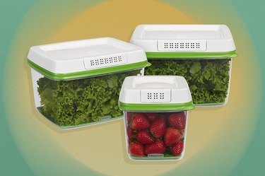 Three clear food storage containers with white lids containing chopped kale and strawberries over yellow and green background.