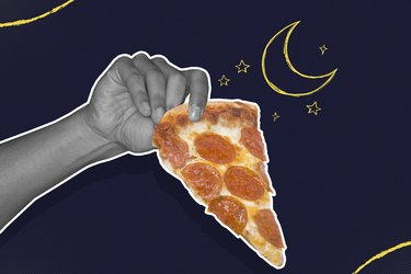 Hand holding a slice of pepperoni pizza on black background with moon and stars