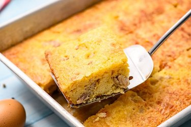 High Protein Bisquick Breakfast Casserole With Sausage with a metal spatula and brown egg