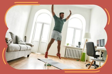 man wearing green shirt and orange sneakers jumping doing 30-day burpee challenge at home