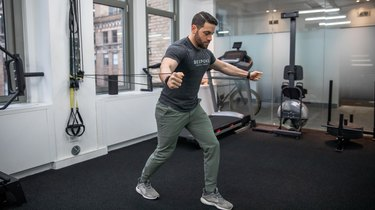 Band-Resisted Split-Stance Chest Fly