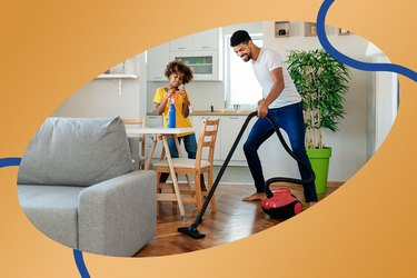 Father and child clean the house together to get more steps throughout the day